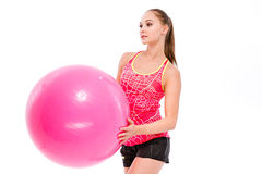 Sports woman holding fitness ball Royalty Free Stock Image
