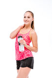 Sports woman holding shaker and looking away Royalty Free Stock Photography