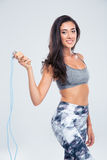 Sports woman holding skipping rope Stock Photo