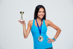 Sports woman holding winner cup Stock Images