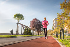 Sports woman jogging Stock Photography