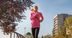 Sports woman jogging Royalty Free Stock Images
