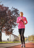Sports woman jogging Royalty Free Stock Photography