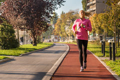 Sports woman jogging Royalty Free Stock Image