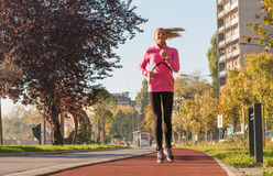 Sports woman jogging Royalty Free Stock Photos