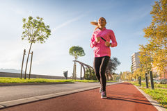 Sports woman jogging Stock Image