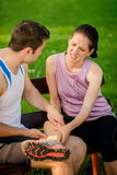 Sports woman with leg injury Royalty Free Stock Images