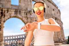 Sports woman near the amphitheatre Royalty Free Stock Images