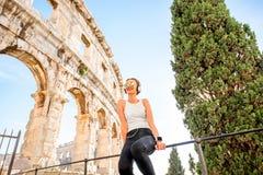 Sports woman near the amphitheatre Stock Image