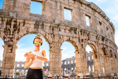 Sports woman near the coliseum Royalty Free Stock Images