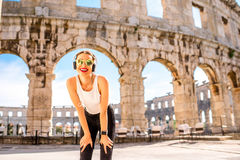 Sports woman near the coliseum Royalty Free Stock Image
