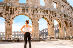 Sports woman near the coliseum Stock Photo