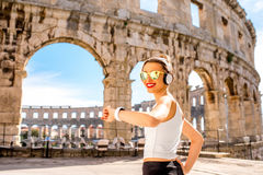 Sports woman near the coliseum Royalty Free Stock Photography