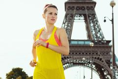Sports woman not far from Eiffel tower in Paris, France jogging royalty free stock images
