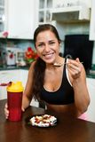 Sports woman and nutritional supplements. Royalty Free Stock Photography