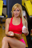 Sports woman and nutritional supplements. Royalty Free Stock Photos