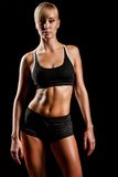Sports woman over black Stock Photography