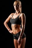 Sports woman over black Stock Images
