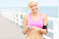 Sports woman with phone Royalty Free Stock Photography