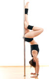 The sports woman and pole Royalty Free Stock Photo