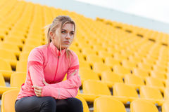 Sports woman resting at stadium Royalty Free Stock Photography