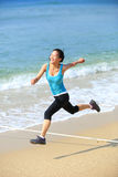 Sports woman running at beach Stock Photo