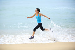 Sports woman running at beach Royalty Free Stock Photo