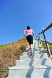 Sports woman running at mountain stairs Stock Images