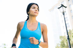 Sports woman running outdoors Royalty Free Stock Photo