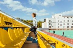 Sports woman running at stadium Royalty Free Stock Photography