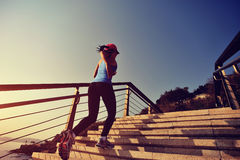 Sports woman running up on stairs sunrise seaside Royalty Free Stock Images