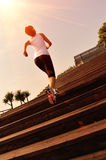 Sports woman running up on wooden stairs Stock Photos