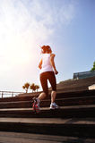 Sports woman running up on wooden stairs Royalty Free Stock Photo