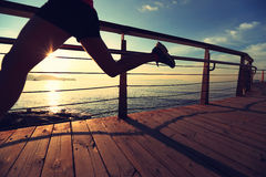 Sports woman running on wooden boardwalk Royalty Free Stock Photo