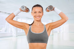 Sports woman with small dumbbells Royalty Free Stock Photography