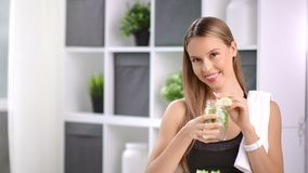 Sports woman smiling drink dietary detox smoothie having positive emotion at light room