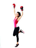 Sports woman standing in boxing gloves Royalty Free Stock Photography