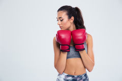 Sports woman standing in defence stance with boxing gloves Royalty Free Stock Image