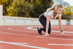 Sports woman in star position for run Stock Image