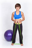Sports woman with stretch band and fit ball royalty free stock photography