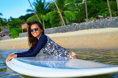 Sports. Woman On Surfboard In Water. Summer Vacation. Leisure Ac. Sports. Active Lifestyle. Healthy Beautiful Happy Fit Young Asian Woman In Blue Wetsuit On royalty free stock photography