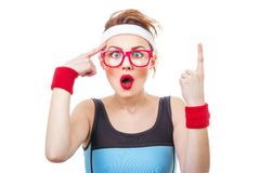Sports woman. Surprised fitness woman gesturing finger up, funny sport girl have idea Royalty Free Stock Image