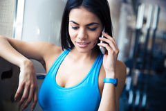 Sports woman talking on the phone Royalty Free Stock Image