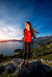 Sports woman on the top of mountain Stock Photos