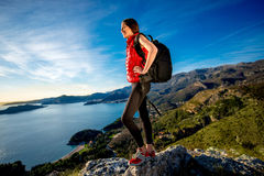 Sports woman on the top of mountain Royalty Free Stock Photo