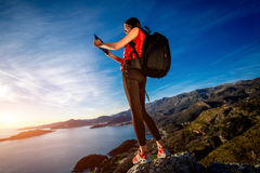 Sports woman on the top of mountain Royalty Free Stock Photos