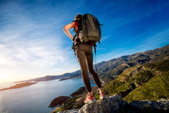 Sports woman on the top of mountain Stock Image
