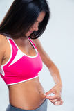 Sports woman touching her belly fat Stock Photo