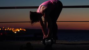 Sports woman tying shoe laces before workout. Sports Woman Tying Shoe Laces. Fitness Female Getting Ready for Jogging or Working Out. Static shot stock video