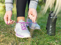 Sports woman tying shoelace before running Stock Photos